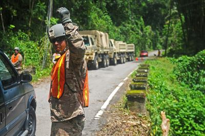 Puerto Rico Army National Guard members work on clearing Highway 511 from Ponce to Jayuya in Puerto Rico, in the aftermath of Hurricane Irma, Sept. 11, 2017. Today, Hurricane Maria is battering the hard-hit island territory. Puerto Rico Army National Guard photo by Spc. Agustin Montanez