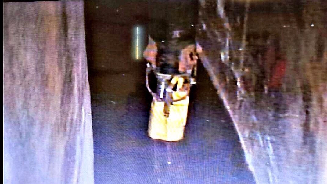 A photo from April 17, 2016 shows liquid covering the floor of the space between the inner and outer shells of a massive tank holding nuclear waste at the Hanford Site in eastern Washington. The tank has been leaking since at least October 2011. (Photo: KING)